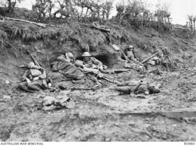 Dead and wounded Australians and Germans in the railway cutting on Broodseinde Ridge, in the Ypres sector, in Belgium, during the battle of Passchendaele, on October 12, 1917.
